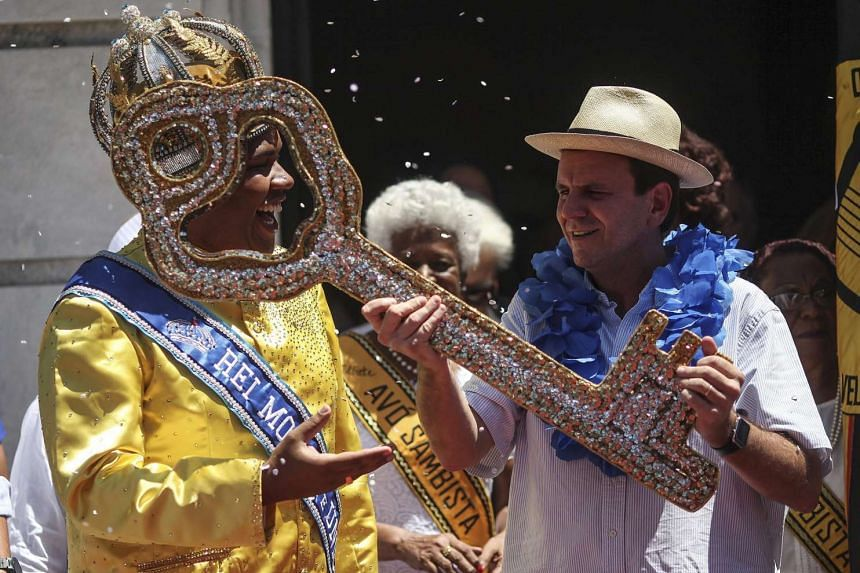 Rio de Janeiro's mayor Eduardo Paes (right) giving the keys of the city to the King Momo, Wilson Dias (left), representing the official opening of the Rio Carnival, on Feb 5.