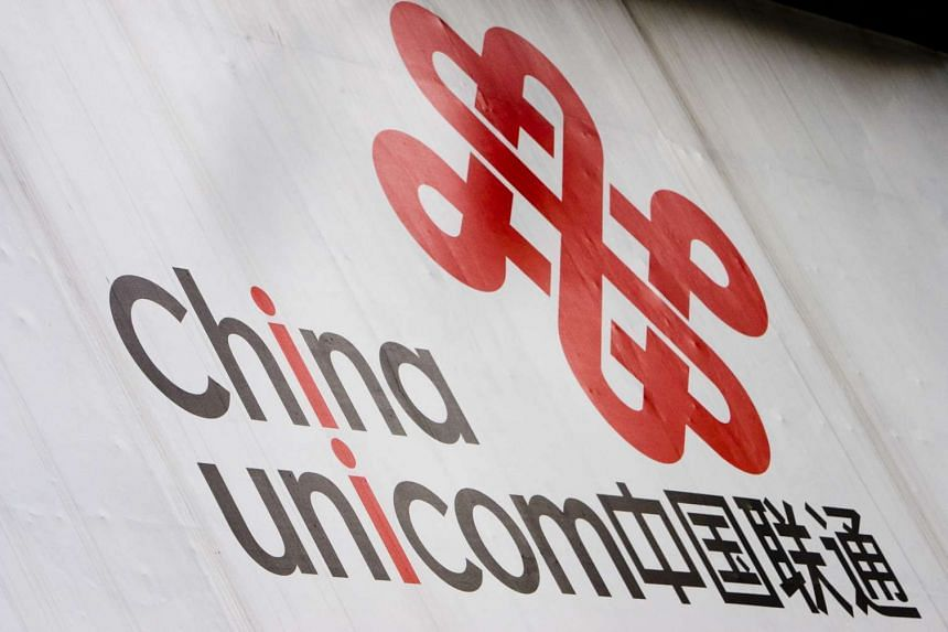 A sign for China Unicom at the entrance of one of the companies's stores in Guangzhou in 2007.