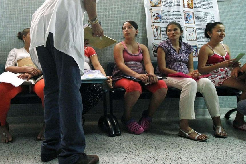 Women wait to be examined for Zika infection at a hospital in Colombia.