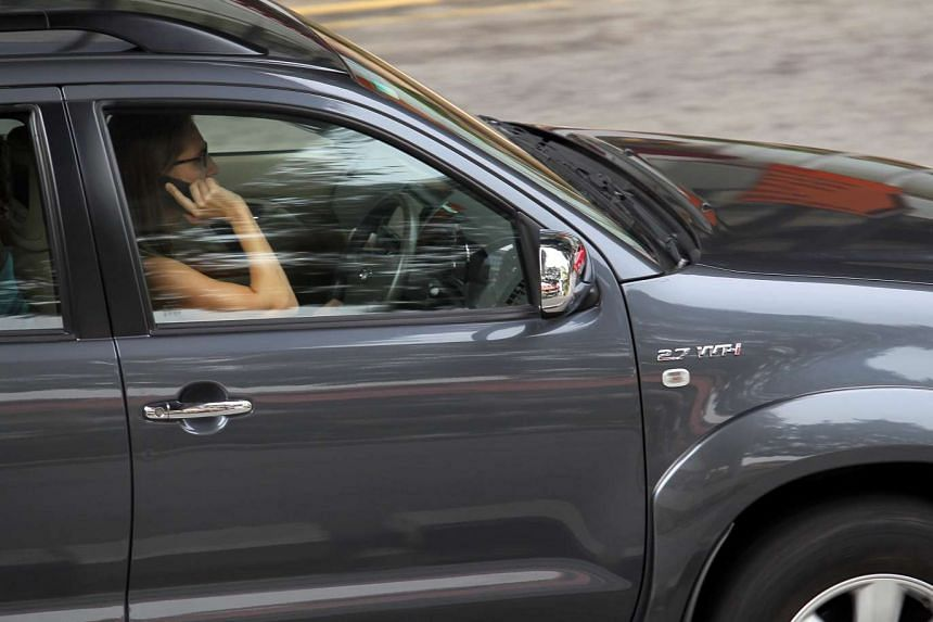 It is illegal for drivers to hold any type of mobile device while driving.