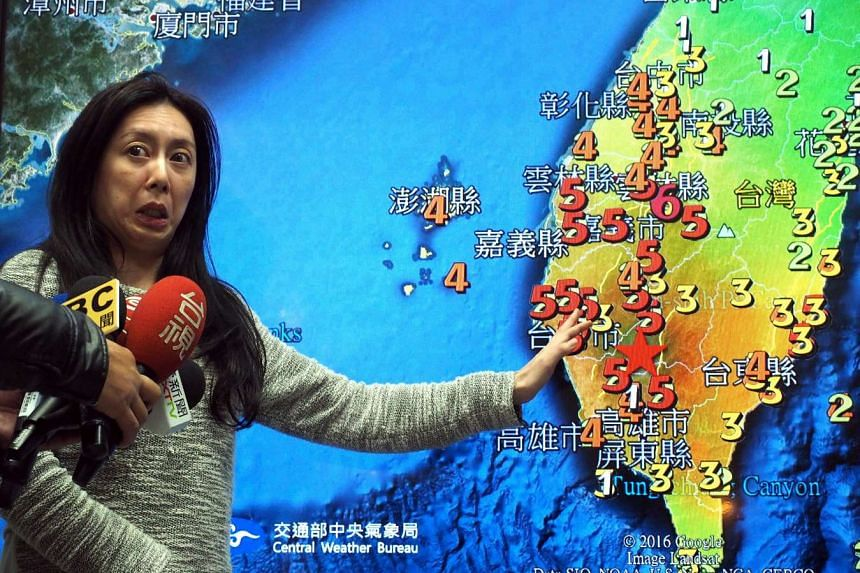 A member of the Seismological Observation Center, Ms Tsai Min-chien, describing to journalists the three earthquakes that hit southern Taiwan on Feb 6, 2016.