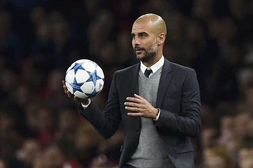 Bayern Munich manager Pep Guardiola holding the ball during his team's Champions League Group F match against Arsenal on Oct 20, 2015.
