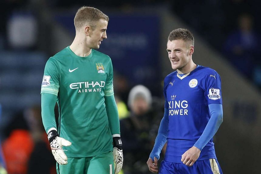 Manchester City's goalie Joe Hart (left) with Leicester City's Jamie Vardy at the end of a game on Dec 29, 2015.