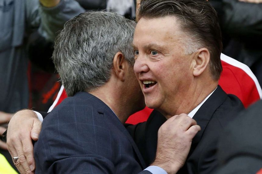 Manchester United manager Louis van Gaal (right) greeting Chelsea manager Jose Mourinho before a match at Old Trafford on Oct 26, 2014.