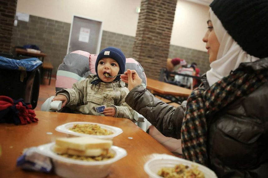 The Mawlana family from Syria eat in the canteen at an asylum seeker reception centre in Emmerzhausen, Germany.