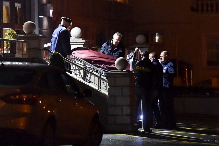 Police removing a body from the scene of a shooting at the Regency Hotel in Dublin on Feb 5.