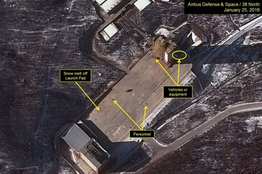 Imagery dated Jan 25, 2016, shows three objects at the base of the Sohae gantry tower that are either vehicles or equipment.