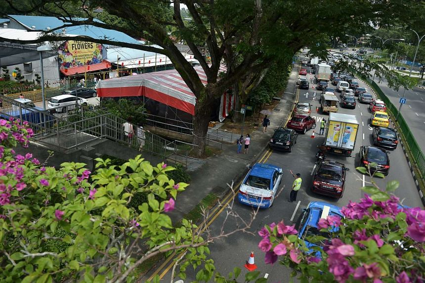 Heavy traffic along Thomson Road yesterday after a stretch of one lane along the road was closed for vehicle parking during non-peak hours, because of the high volume of patrons expected at the nurseries.