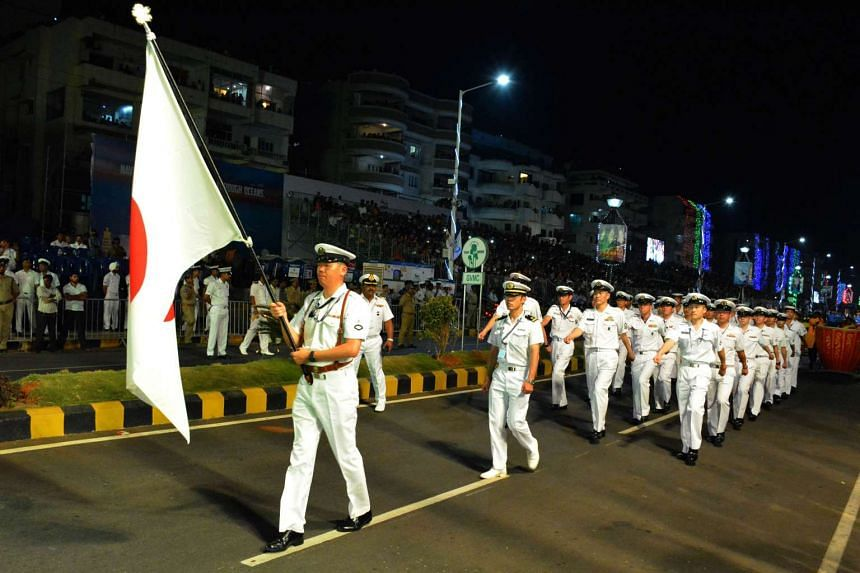 Japanese naval personnel in a parade on Thursday, ahead of the International Fleet Review. The five-day review involves 90 warships from countries including China, the United States, France and Malaysia.