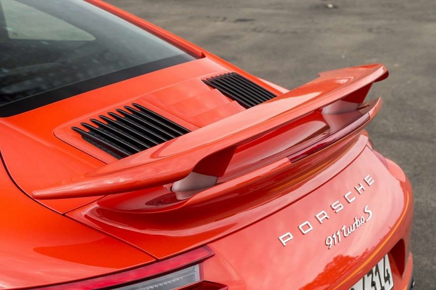The new Porsche 911 Turbo has larger front air intakes and an engine cover at the back with longitudinal slates.