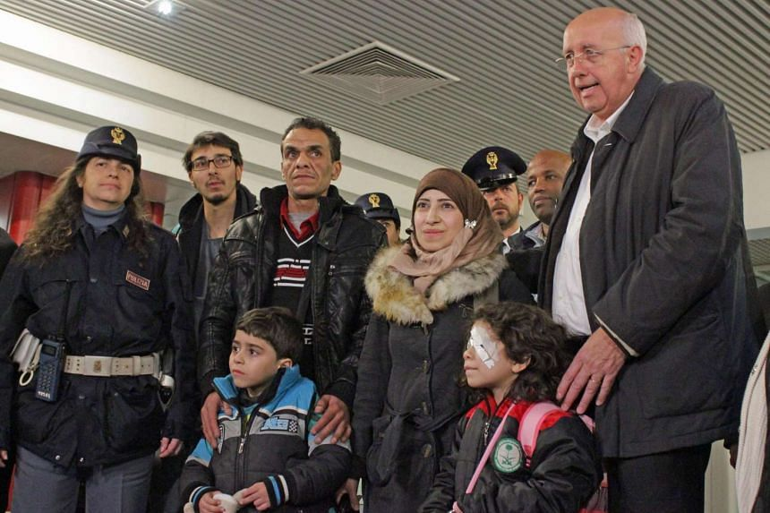 Falek Al Hourani (second from right), a seven-year-old suffering from eye cancer, beside her mother Yasmine at Rome's Fiumicino airport on Thursday. Her family, including her father and six-year-old brother, were the first to be flown out of Lebanon