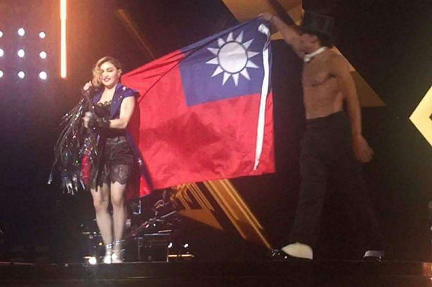 A photograph supplied by a member of the audience shows pop star Madonna with the Taiwan flag as she performed an encore during her concert in Taipei on Thursday.