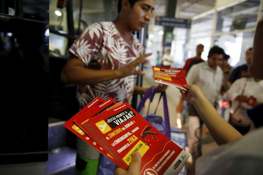 Information about the Zika virus being distributed on Thursday to travellers at a bus station in Lima in a campaign by Peru's Health Ministry.