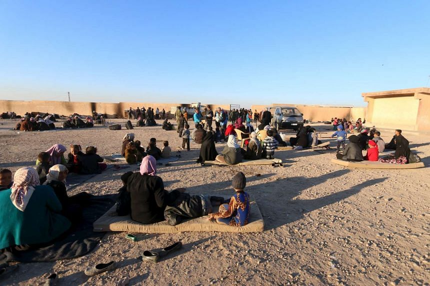 Displaced families sitting at a school in al-Mabroukeh village in the western countryside of Ras al-Ain, Syria, on Dec 28, 2015.