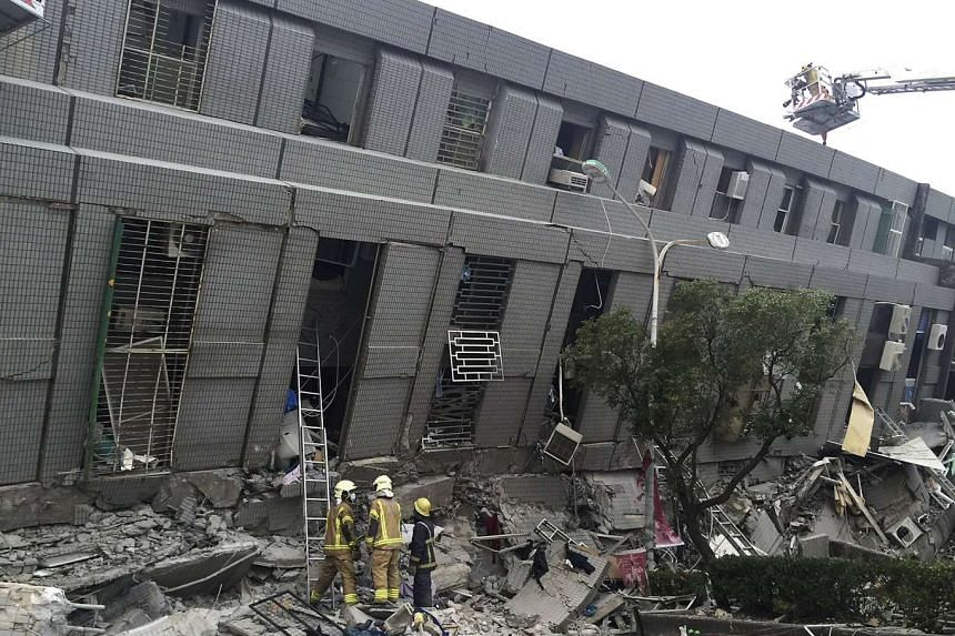Rescue personnel working at a damaged building after an earthquake in Tainan, southern Taiwan, on Feb 6, 2016.