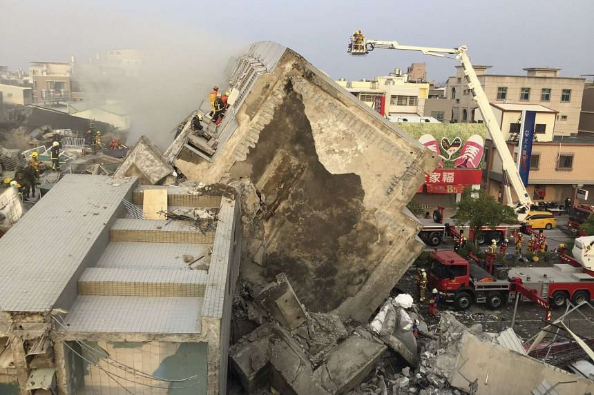 Rescue personnel working on the damaged buildings after an earthquake in Tainan, southern Taiwan, on Feb 6, 2016.