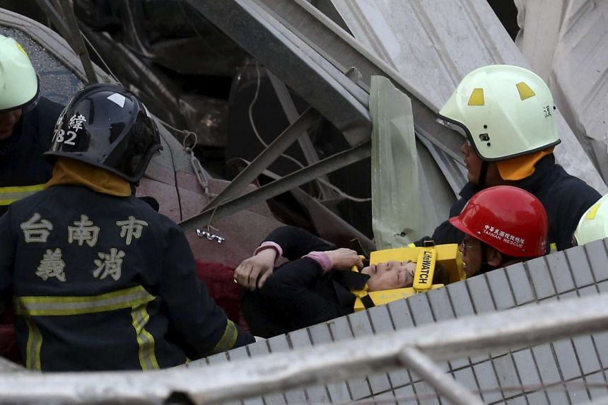 Rescuers evacuating a victim at the site where a 17-storey apartment collapsed after the Feb 6 earthquake in Tainan.