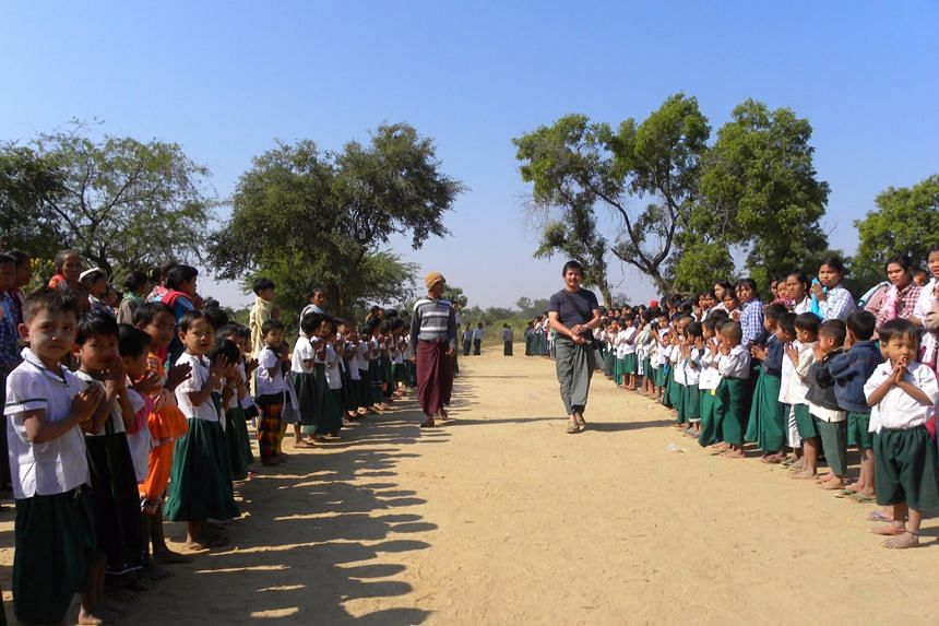 Mr Ben Cheong (in T-shirt), founder of Magical Light Foundation, at the opening ceremony of the first school he built in Myanmar.
