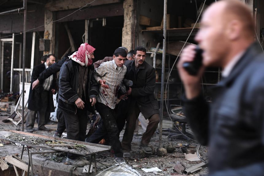 A Syrian man injured in an air strike on a rebel-held region in December last year. The Arab Spring protests in Syria have led to the worst of both worlds: the preservation of a brutal dictatorship that attacks civilians, and a power vacuum in territ