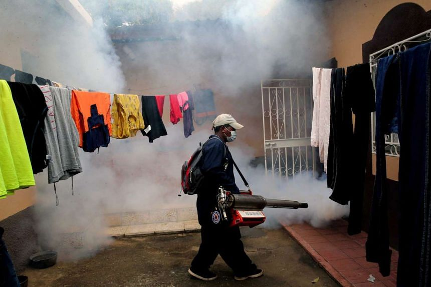 A government employee fumigating a house to prevent the possible spreading of the Zika virus in Catacamas, Honduras on Feb 6, 2016.