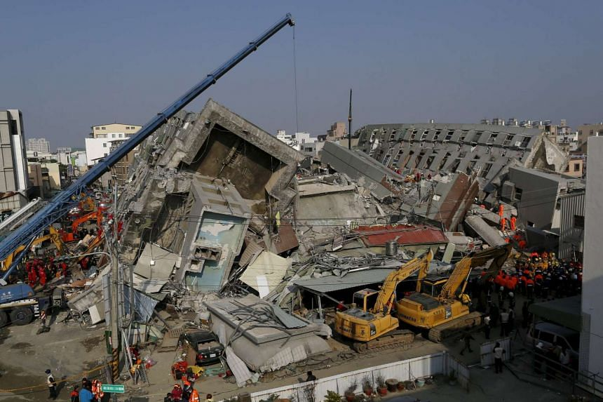 Rescue personnel work at the site where a 17-storey apartment building collapsed, after an earthquake in Tainan, southern Taiwan on Feb 7, 2016.