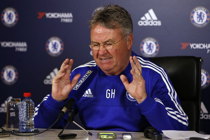 Chelsea interim manager Guus Hiddink at a press conference on Friday. Amid the recent throng of transfers to the Chinese Super League, he revealed he had an offer to join a team in the cash-rich competition.