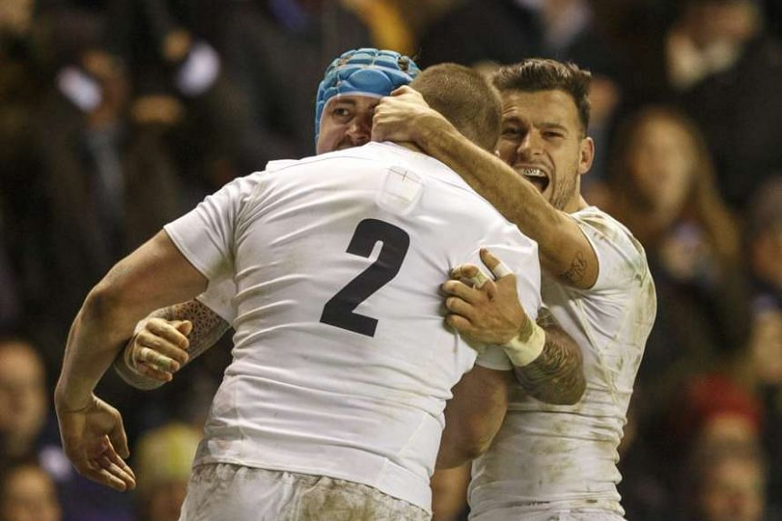England's Jack Nowell (left) celebrates with teammates Dylan Hartley (centre) and Danny Care (right) after scoring the 2nd try.