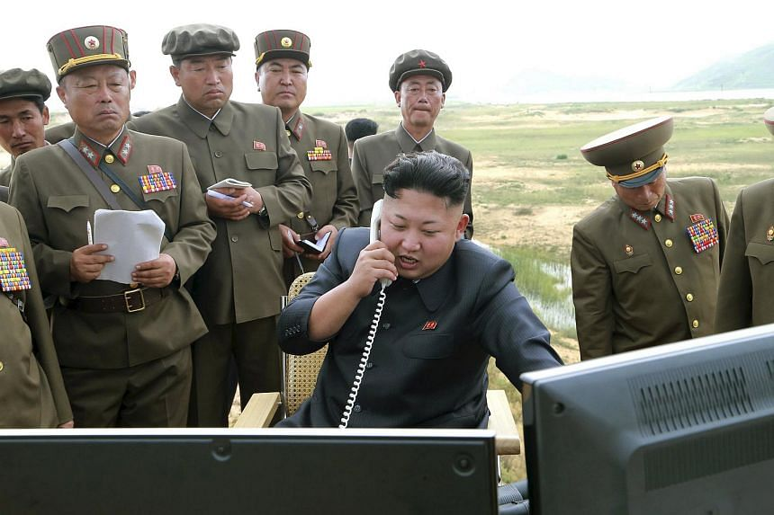 North Korean leader Kim Jung Un guides the test fire of a tactical rocket in this undated file photo released by North Korea's Korean Central News Agency.