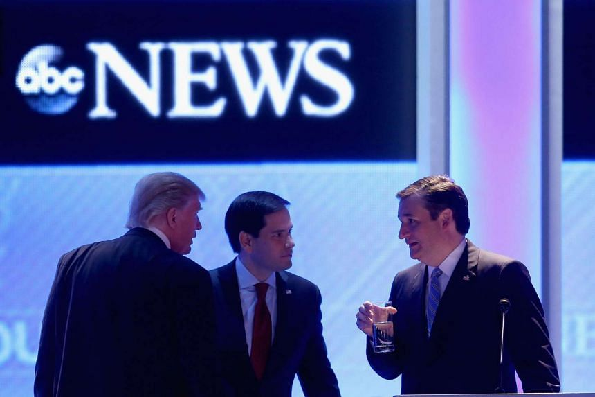 Republican presidential candidates (from left): Donald Trump, Senator Marco Rubio and Senator Ted Cruz talk during a commercial break in the Republican presidential debate.