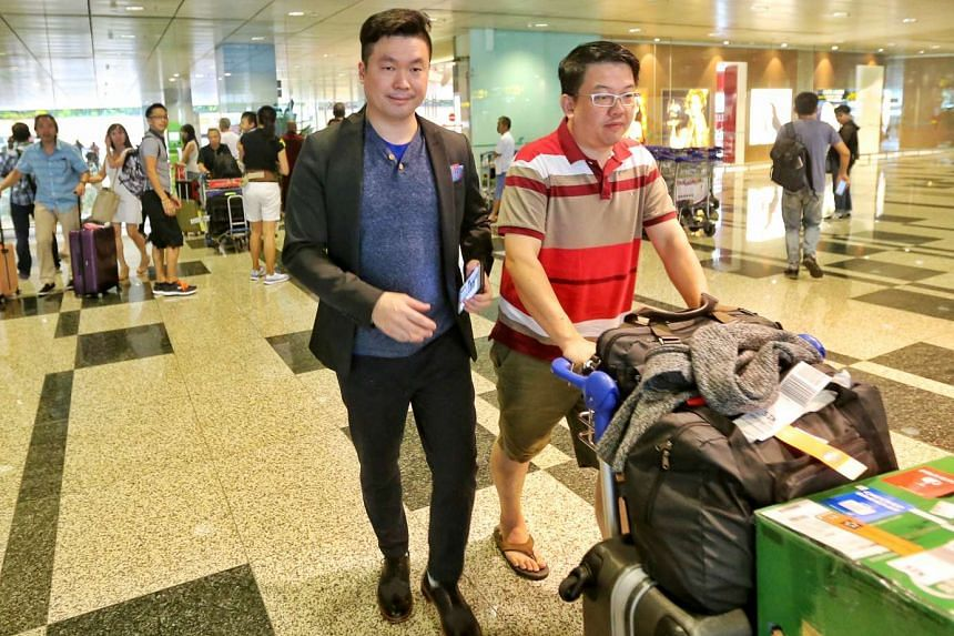 Singaporean Luo Junfa (left), arriving at Changi Airport from Taiwan on Saturday (Feb 6) afternoon.