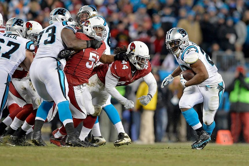 Jonathan Stewart #28 of the Carolina Panthers carries the ball in the first half against the Arizona Cardinals during the NFC Championship Game.