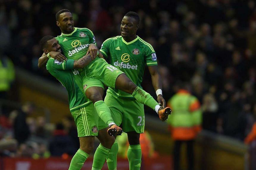 Sunderland's Jermain Defoe (centre) is congratulated after scoring the fourth goal.
