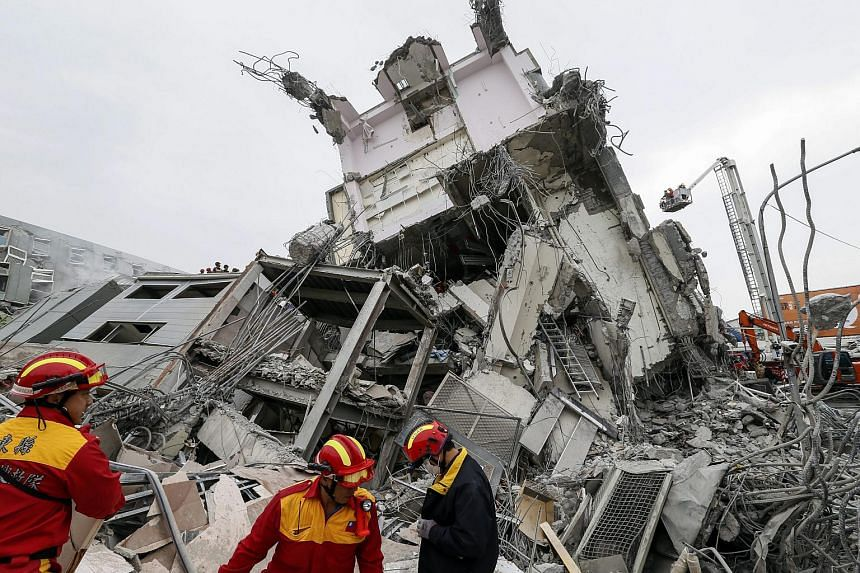 Rescuers search for survivors from a collapsed building following an earthquake that struck the area in Tainan City, Taiwan, on Feb 6, 2016.