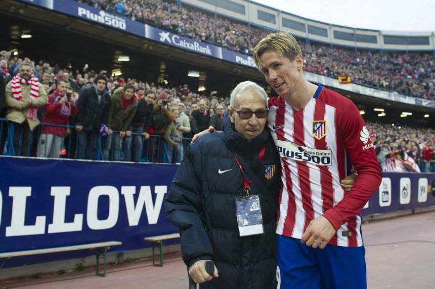 Torres (right) with Atletico de Madrid Football College founder Manuel Brinas after the match.