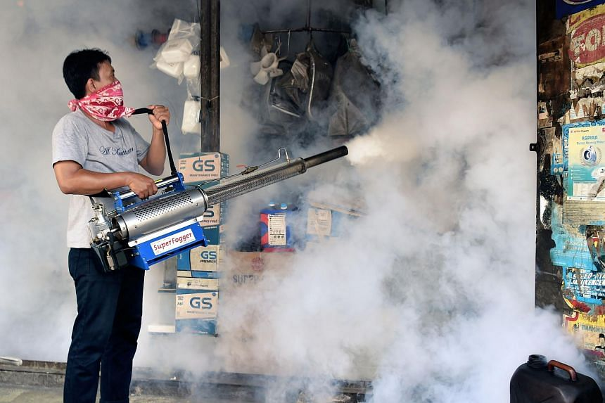 A man fumigates against the Aedes Aegypti mosquitos in Jakarta, on Feb 6, 2016.