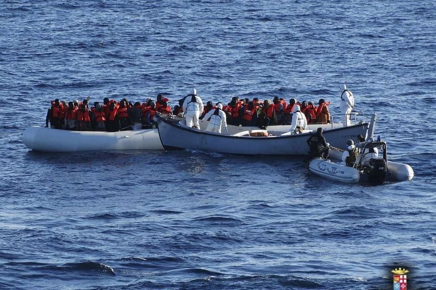 Migrants are rescued by the Italian Navy in the Mediterranean Sea on Jan 28, 2016.