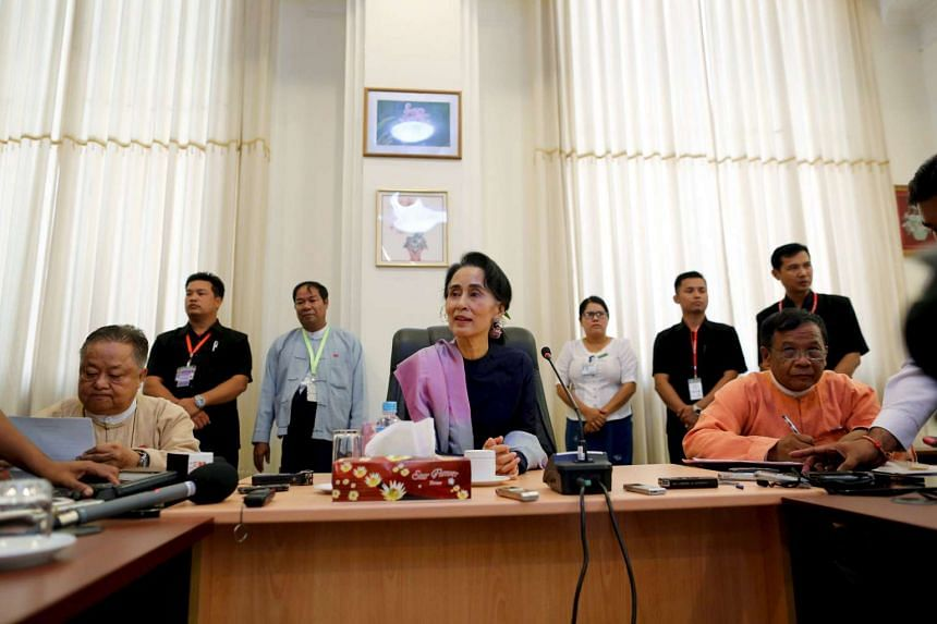 The National League for Democracy denied that they will change the constitution to allow Aung San Suu Kyi (above, centre) to assume presidency.