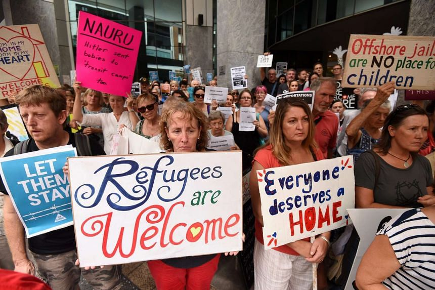 Pro-refugees protesters rally outside the Immigration Office in Brisbane, Australia on Feb 5, 2016.