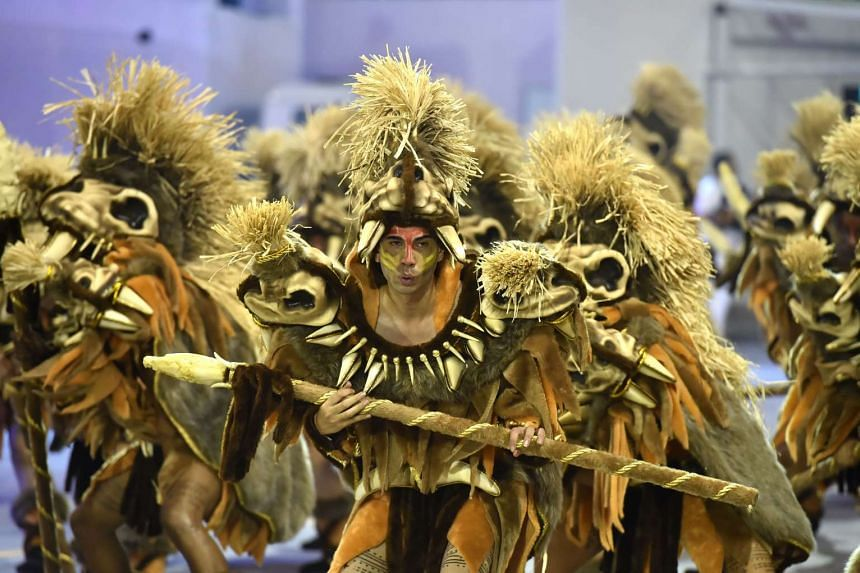 Revelers of the Rosas de Ouro samba school perform during the first night of the carnival parade at the Sambadrome in Sao Paulo, Brazil, on Feb 6, 2016.