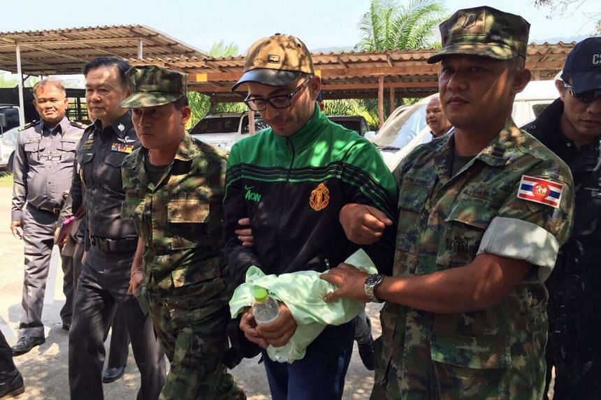 Artur Segarra Princep (centre) being escorted by Thai soldiers after he was arrested in Cambodia and sent back to Thailand on Feb 8, 2016.