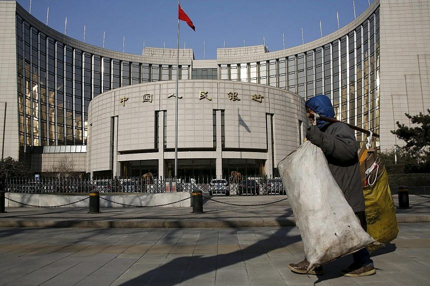 China's foreign reserves are continuing to decline amid a deepening economic slowdown, a weakening yuan and plunging stocks. The People's Bank of China (left) has stepped up efforts to stem the exodus.