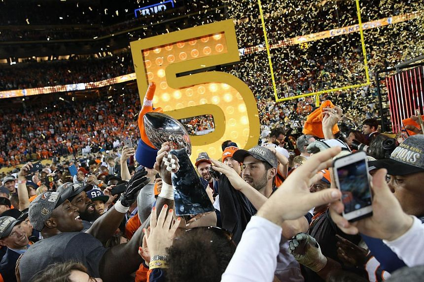 The Denver Broncos celebrating with the Vince Lombardi Trophy after Super Bowl 50 at Levi's Stadium on Feb 7, 2016.