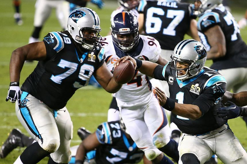 Cam Newton #1 of the Carolina Panthers scrambling with the ball against the Denver Broncos in the fourth quarter during Super Bowl 50 at Levi's Stadium on Feb 7, 2016.