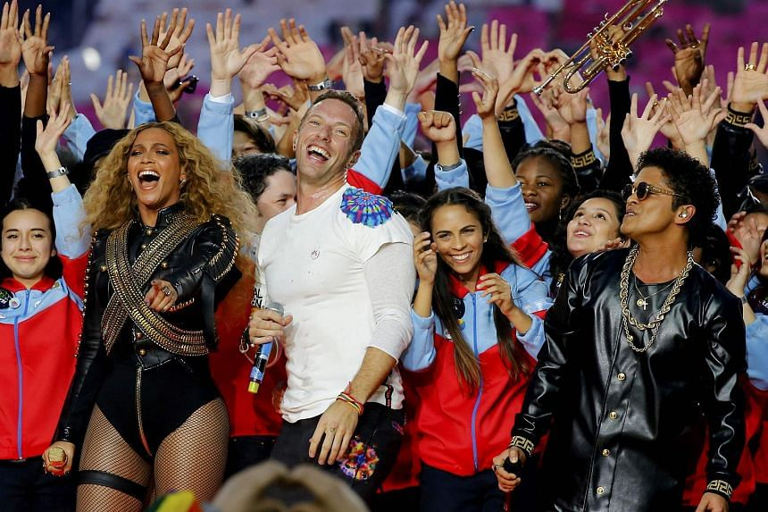 Beyonce (left), Chris Martin (centre) and Bruno Mars performing during the half-time show at the NFL's Super Bowl 50 between the Carolina Panthers and the Denver Broncos on Feb 7, 2016.