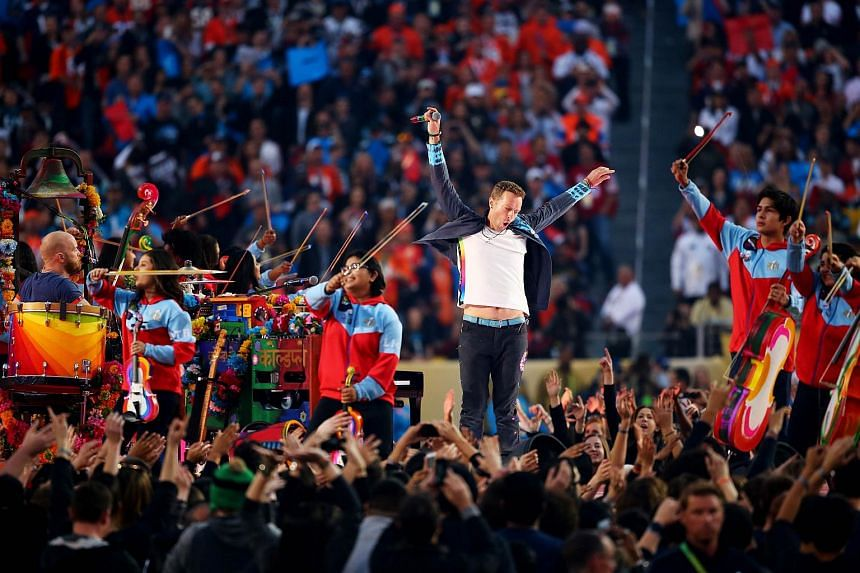 Chris Martin of Coldplay performing during the half-time show at the NFL's Super Bowl 50 football game.