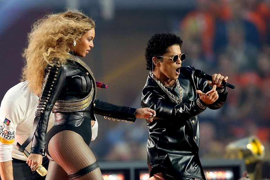 Beyonce (left) and Bruno Mars performing during the half-time show at the NFL's Super Bowl 50 football game.