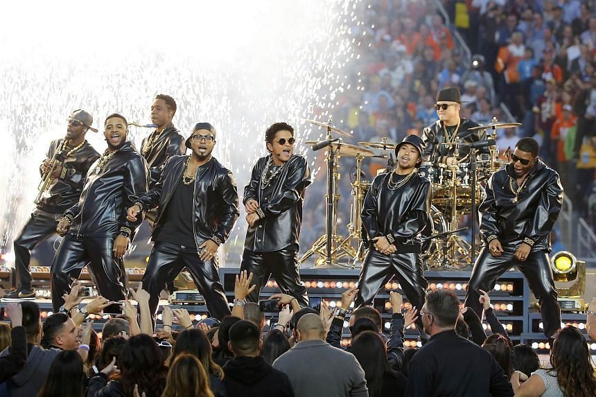 Bruno Mars (centre, in sunglasses) performing during the half-time show at the NFL's Super Bowl 50 football game.