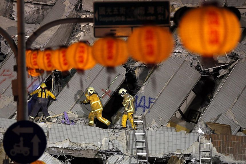 Rescuers continue their search for survivors from a collapsed building in Tainan, Taiwan, on the eve of the Chinese New Year.