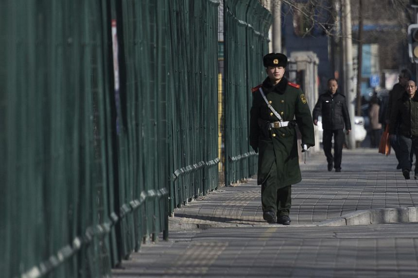 A Chinese paramilitary guard walking next to the North Korean Embassy in Beijing on Feb 7, 2016.