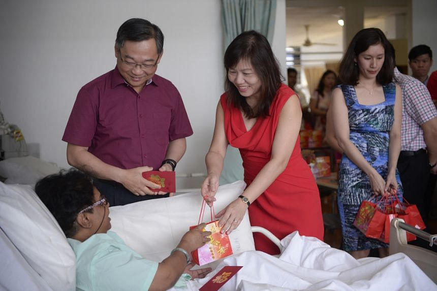 Health Minister Gan Kim Yong and his wife greeting a patient at National University Hospital (NUH) on Feb 8, 2016.